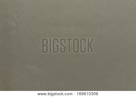 the textured background of fabric or textile material of pale or faded khaki color