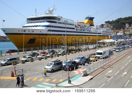 NICE, FRANCE - JUL 26, 2016: Corsica Ferries pleasure yacht in port of city. In 40 years Corsica Ferries became leading private ferry company for trips to Corsica and Sardinia