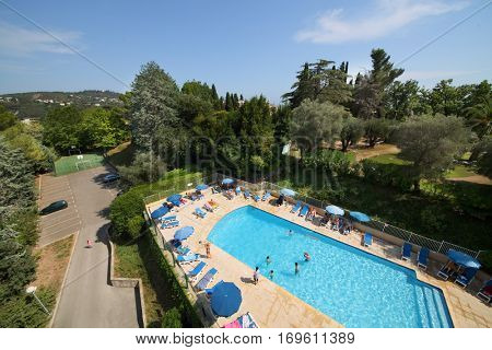 CANNES, FRANCE - JUL 26, 2016: Pool with clean water near Hotel Les Agapanthes. Les Agapanthes offers aange of services and entertainment, depending on season