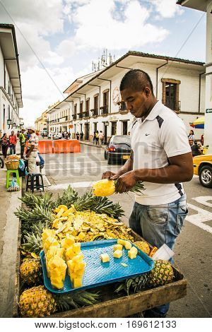 popayan, colombia - November, 27th, 2015 - fruit seller in white city popayan colombia south america