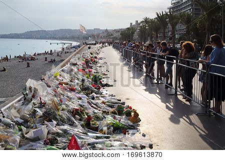 NICE, FRANCE - JUL 24, 2016: Flowers on quay after terrorist attack July 14, 2016, 86 people were killed under wheels of truck