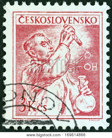 CZECHOSLOVAKIA - CIRCA 1954: A stamp printed in Czechoslovakia shows a chemist, circa 1954.