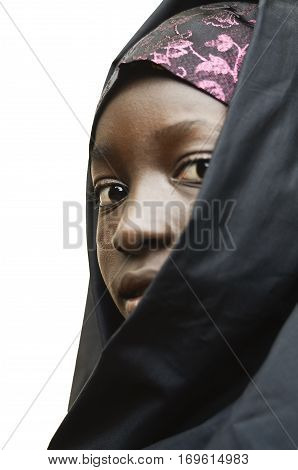 Vertical Little Young African School Girl Posing Outdoors Veiled by a Black Niqab