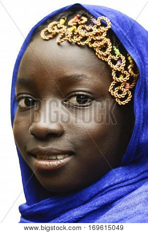 Gorgeous Smiling African Schoolgirl Veiled by a Blue Typical African Clothing