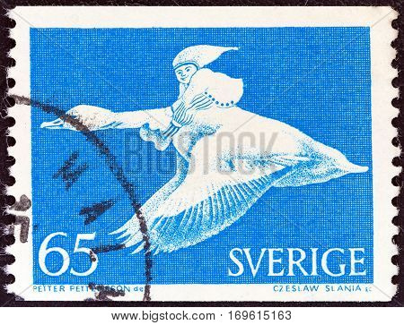 SWEDEN - CIRCA 1971: A stamp printed in Sweden shows Nils Holgersson on goose (from the wonderful adventures of Nils by Selma Lagerlof), circa 1971.