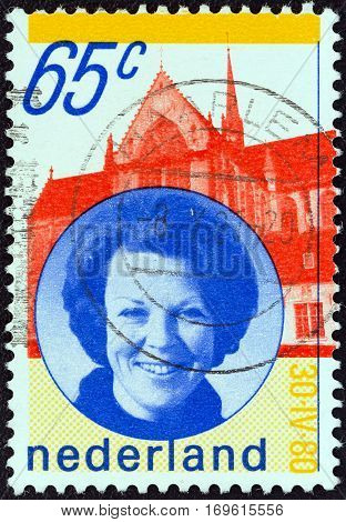 NETHERLANDS - CIRCA 1980: A stamp printed in the Netherlands issued for the installation of Queen Beatrix shows Queen Beatrix and New Church, Amsterdam, circa 1980.