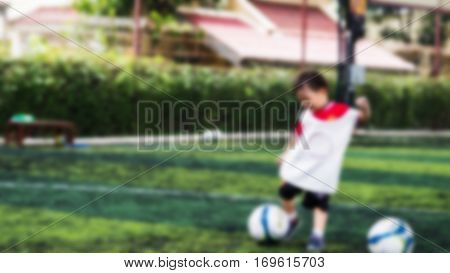 Blurred Youth Soccer Player Shooting Ball