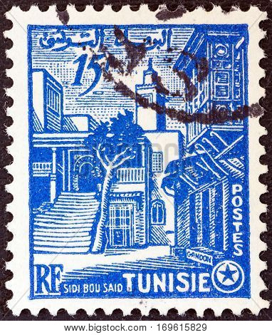TUNISIA - CIRCA 1954: A stamp printed in Tunisia shows a street, Sidi-bou-said, circa 1954.