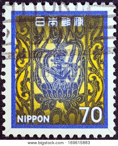 JAPAN - CIRCA 1980: A stamp printed in Japan shows flautist, Horyu temple, circa 1980.