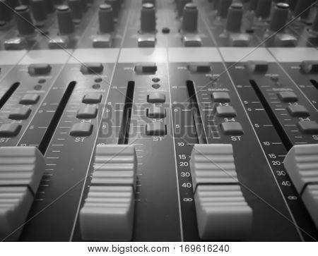 Closeup audio mixer music equipment monochrome picture