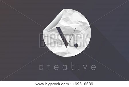 V Letter Logo with Crumpled And Torn Wrapping Paper Texture Vector.