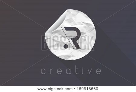 R Letter Logo with Crumpled And Torn Wrapping Paper Texture Vector.