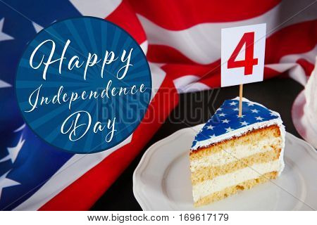 Slice of delicious cake on plate. Text HAPPY INDEPENDENCE DAY on American flag background