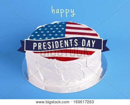 Delicious cake with American flag decor on blue background. Text HAPPY PRESIDENTS DAY