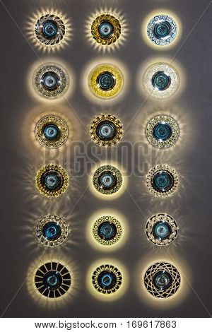 Group of different pot ceiling lights. Recessed lighting in ceiling tile