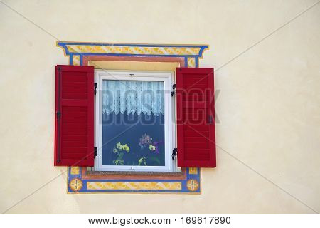 Beautiful Window With Red Shutters In Small Alpine Country House