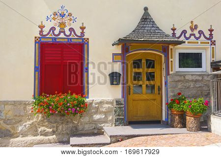 Traditional Facade Of Alpine House, Dolomites, Italy