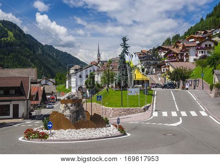 Scenic view of the streets in alpine village in the green valley among the mountain hills St Christina Dolomites South Tyrol Italy