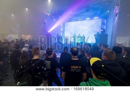 Moscow, Russia - December 9, 2016: People attend rap battle at Vapexpo Moscow 2016 exhibition which presents new modern vape gadgets, liquids and flawours