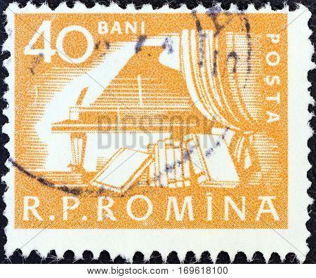 ROMANIA - CIRCA 1960: A stamp printed in Romania shows Grand piano and books, circa 1960.