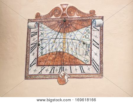 Colorful Sundial Painted On Old Building Wall