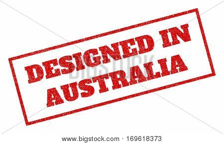 Red rubber seal stamp with Designed In Australia text. Vector caption inside rectangular banner. Grunge design and scratched texture for watermark labels. Inclined sign.