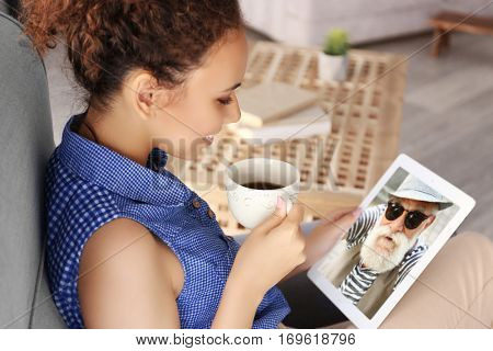 Video call and chat concept. Woman video conferencing on tablet