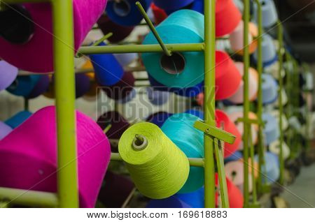 Reels with threads. Textile industry - Weaving and warping.