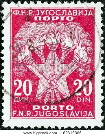 YUGOSLAVIA - CIRCA 1952: A stamp printed in Yugoslavia shows 5 Torches and Star, the Coat of Arms of Yugoslavia, circa 1952.