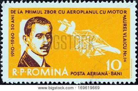 ROMANIA - CIRCA 1960: A stamp printed in Romania issued for the 50th anniversary of 1st Flight by Aurel Vlaicu and Aviation Day shows Aurel Vlaicu and his Airplane No. 1 Crazy Fly, circa 1960.