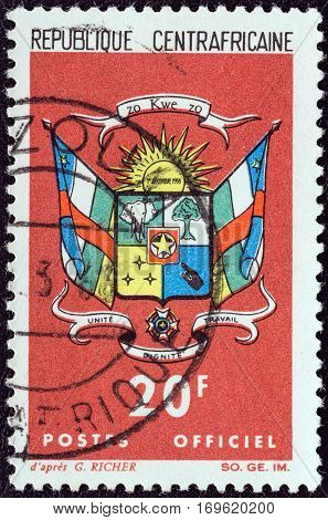 CENTRAL AFRICAN REPUBLIC - CIRCA 1965: A stamp printed in Central African Republic shows Coat Of Arms, circa 1965.