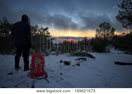 man looking at last sunset of the year 2016 in winter Etna Park, Sicily