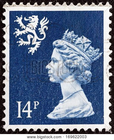 UNITED KINGDOM - CIRCA 1988: A stamp printed in Scotland shows Queen Elizabeth II and Royal Arms of Scotland, circa 1988.
