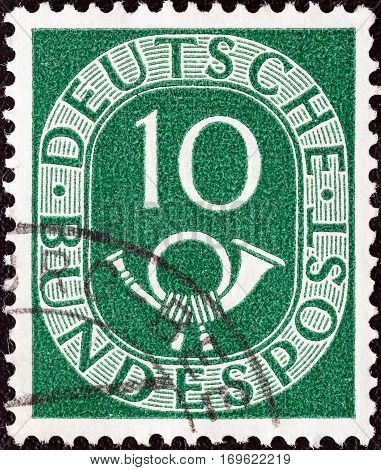 GERMANY - CIRCA 1951: A stamp printed in Germany shows Numeral value and Posthorn, circa 1951.
