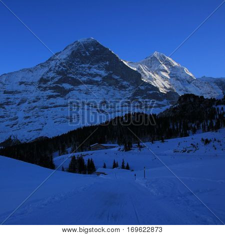 Famous Eiger north face in winter Switzerland.