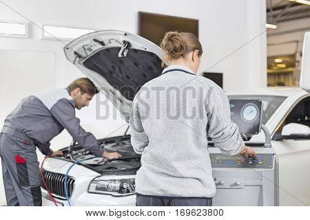 Automobile mechanics working in automobile repair shop
