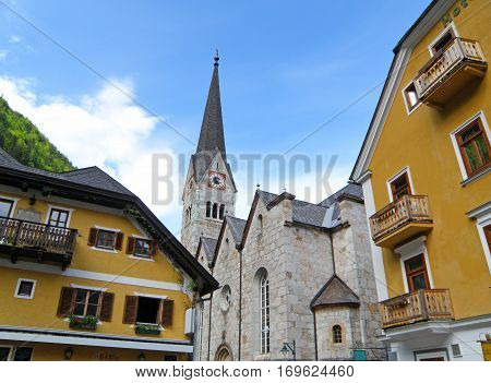 Beautiful Church and Maria Theresa Yellow Colored Architecture in Hallstatt, Austria