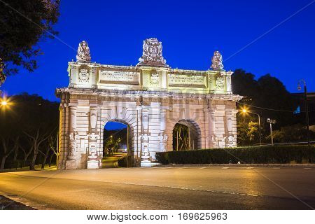 Floriana Malta - Early in the morning at Porte des Bombes or Floriana Gate to Valletta with empty street and clear blue sky