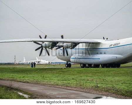Kiev Region Ukraine - September 25 2008: Antonov An-22 turboprop cargo plane on the taxiway and Antonov An-225 Mriya on the background