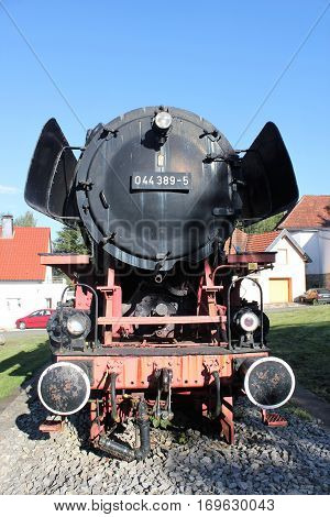 the front side of an old steam locomotive in altenbeken