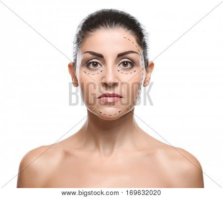 Mature woman with marks on face against white background. Plastic surgery concept