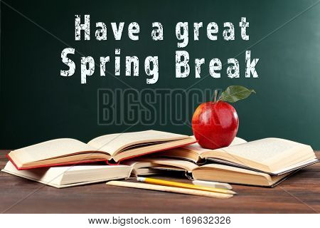 Text HAVE A GREAT SPRING BREAK on chalkboard. Additional education concept