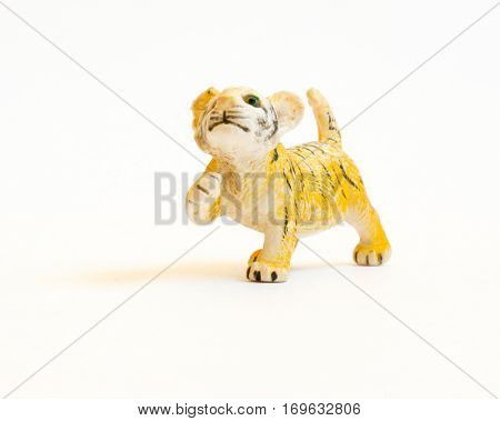 The Miniature isolated toy tiger.