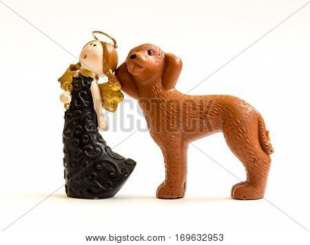 GOMEL, BELARUS - September 10, 2014: Miniature toy dog and girl, made in Soviet times. Soviet Union was a socialist state on the Eurasian continent that existed between 1922 and 1991.