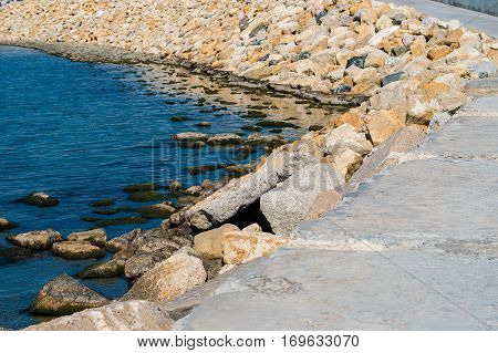 Some marine backwater and stone breakwater bright day.