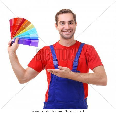 Young decorator holding samples for choosing color, on white background