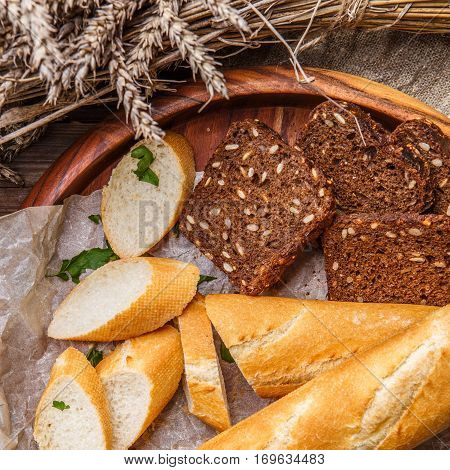 Fresh home bread in wooden plate on table