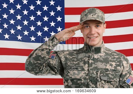 Saluting soldier with USA flag on background