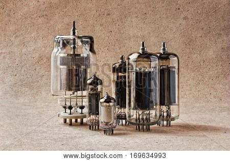different tipes of old radio lamps on kraft paper background