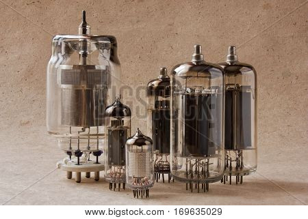 horizontal composition of different electronic vacuum tubes on kraft paper. vintage radio lamps